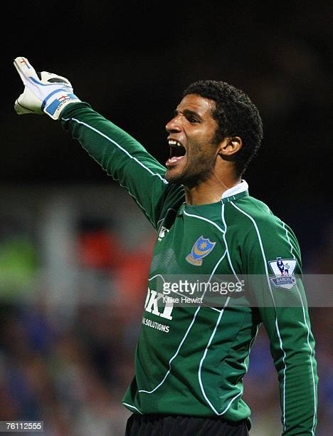 Portsmouth goalkeeper David James directs his defence during the Barclays Premier League match between Portsmouth and Manchester United at Fratton...