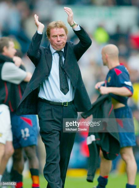 Portsmouth manager Harry Redknapp applauds the travelling fans at the final whistle during the FA Barclaycard Premiership match between Leeds United...
