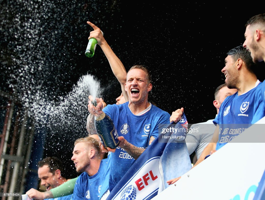Portsmouth players celebrate winning the league after the Sky Bet League Two match between Portsmouth and Cheltenham Town at Fratton Park on May 6, 2017 in Portsmouth, England.
