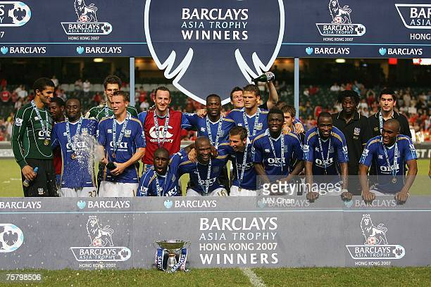 Portsmouth players celebrate with the trophy after winning the preseason Barclays Asia Trophy final match between Liverpool FC and Portsmouth FC at...