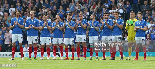 Portsmouth players observe a minutes applause to the memory of Portsmouth fans who had passed away during the 2015/2016 season prior to the Sky Bet...