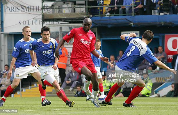 Portsmouth, UNITED KINGDOM: Liverpool's Mohamed Sissoko takes on the Portsmouth defence as he tries to beat Dejan Stefanovic during their English...