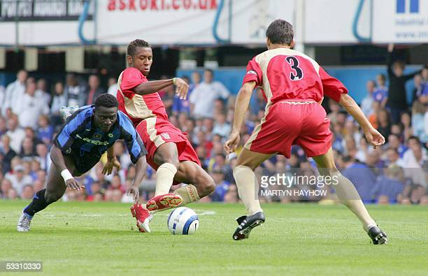 Portsmouth, UNITED KINGDOM: Portsmouth's Lomana Lualau out-turns Obafemi Martins of Internazionale Milan in the pre season friendly match at Fratton...