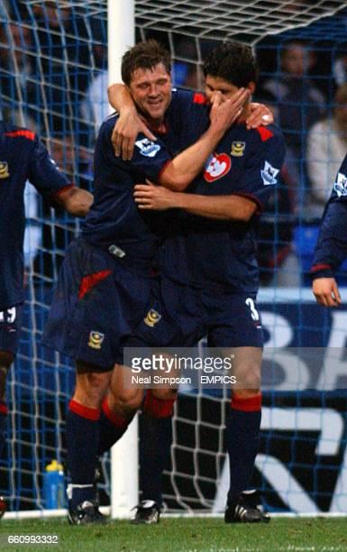 Portsmouth's Arjan De Zeeuw is congratulated on scoring their opening goal by Dejan Stefanovic