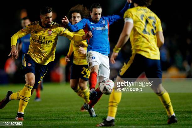 Portsmouth's Australian midfielder Ryan Williams is challenged by Arsenal's Spanish defender Pablo Mari during the English FA Cup fifth round...