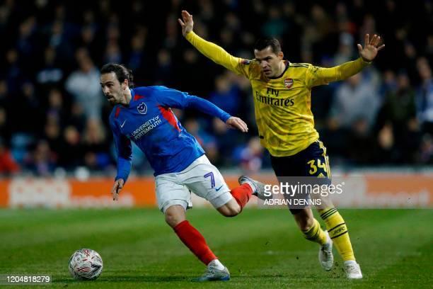 Portsmouth's Australian midfielder Ryan Williams runs away from Arsenal's Swiss midfielder Granit Xhaka during the English FA Cup fifth round...