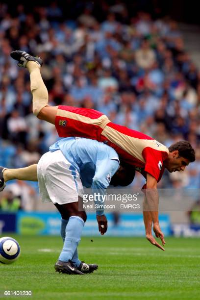 Portsmouth's Dejan Stefanovic clambers over the top of Manchester City's Andy Cole