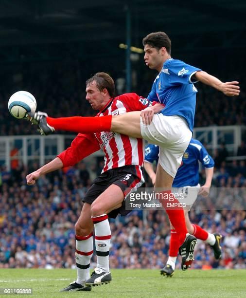 Portsmouth's Dejan Stefanovic clears the danger from Southampton's Claus Lundekvam