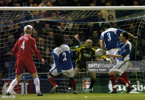 Portsmouth's Dejan Stefanovic hand balls to give Liverpool a penalty during the FA Cup fourth round match at Fratton Park, Portsmouth, Sunday January...