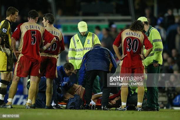 Portsmouth's Dejan Stefanovic receives treatment after picking up a facial injury