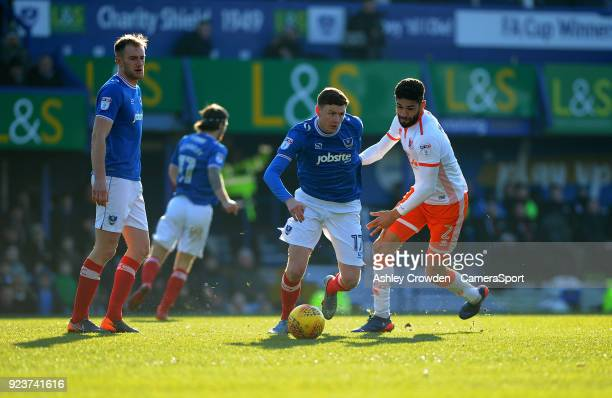 Portsmouth's Dion Donohue vies for possession with Blackpool's Kelvin Mellor during the Sky Bet League One match between Portsmouth and Blackpool at...