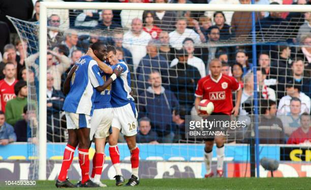 Portsmouth's Djimi Traore and Gary O'Neil celebrate going 20 up after Manchester United's Rio Ferdinand scored an own goal during their Barclays...