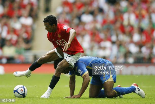 Portsmouth's English Defender Glen Johnson vies with Manchester United's Portuguese Midfielder Nani during the FA Community Shield at Wembley Stadium...