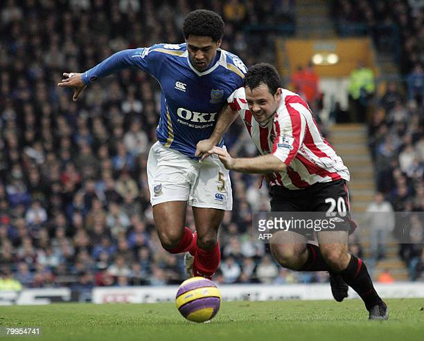 Portsmouth's English defender Glen Johnson vies with Sunderland's Andy Reid during their Premiership match against Sunderland at Fratton Park in...