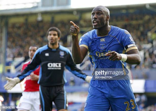Portsmouth's English defender Sol Campbell gestures to the linesman after a penalty is given during the Premier League football match between...