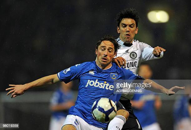 Portsmouth's English forward Tommy Smith vies with Chelsea's Portuguese defender Paulo Ferreira during the English Premier League football match...