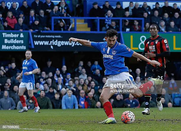 Portsmouth's English midfielder Gary Roberts shoots to score his team's first goal during the English FA Cup fourth round football match between...