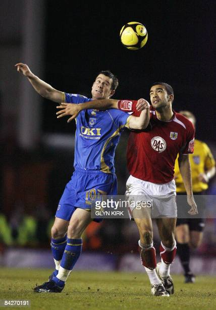 Portsmouth's English striker David Nugent vies with Bristol City's English defender Liam Fontaine during their FA Cup third round replay match...