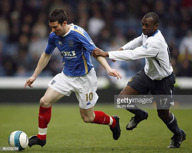 Portsmouth's English striker David Nugent vies with Wigan's English defender Emmerson Boyce during their Premiership match against Wigan at Fratton...