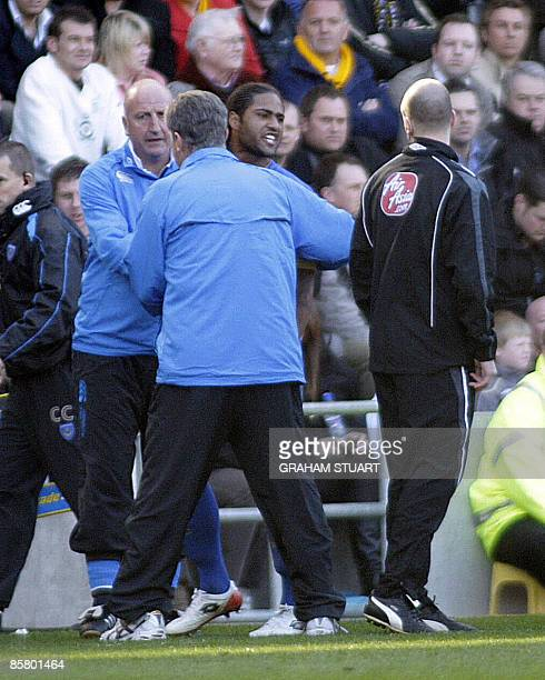Portsmouth's Glen Johnson is ushered off the field by manager, Paul Hart after being sent-off against Hull City during an English FA Premier League,...