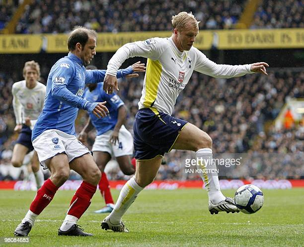 Portsmouth's Greek player Angelos Basinas vies with Tottenham's Icelandic striker Eidur Gudjohnsen during the English Premier League football match...