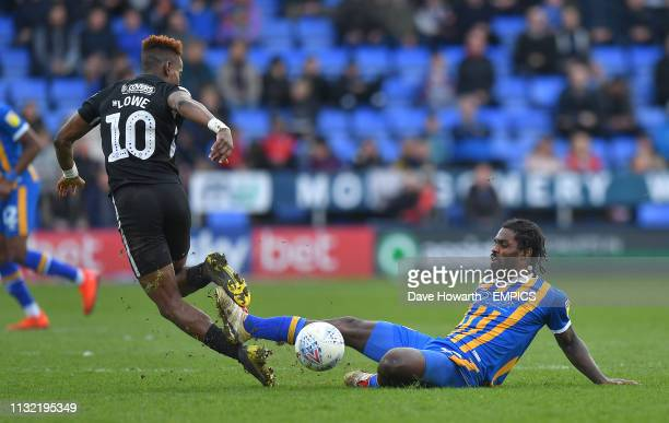 Portsmouth's Jamal Lowe is fouled by Shrewsbury Town's Anthony Grant Shrewsbury Town v Portsmouth Sky Bet League One Montgomery Waters Meadow