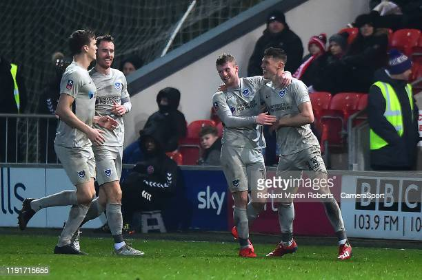 Portsmouth's James Bolton celebrates scoring his side's first goal with his teammates during the FA Cup Third Round match between Fleetwood Town and...