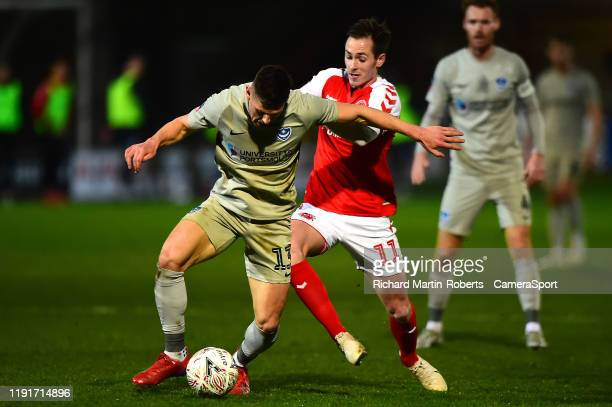 Portsmouth's James Bolton vies for possession with Fleetwood Town's Josh Morris during the FA Cup Third Round match between Fleetwood Town and...