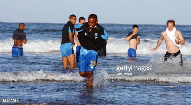 Portsmouth's Jermain Defoe laughs as the team celebrate in the Atlantic Ocean following their late night victory in the UEFA Cup Ist round 2nd leg...