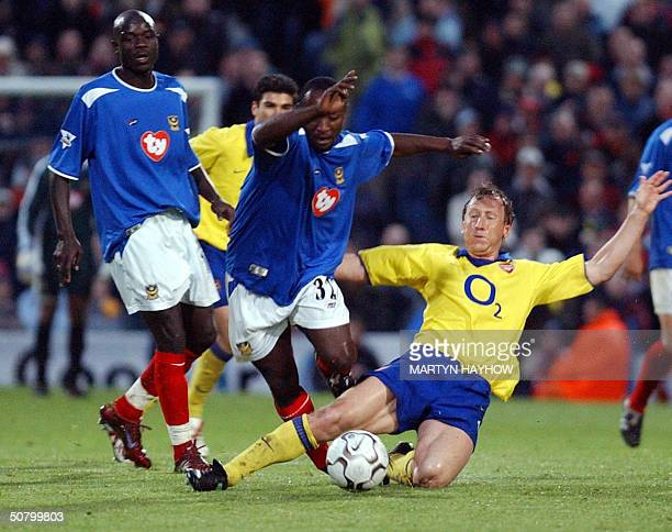 Portsmouth's Lomana Lua Lua avoids a tackle by Arsenal's Ray Parlour 04 May 2004 during their league match in Portsmouth AFP PHOTO/ Martyn HAYHOW