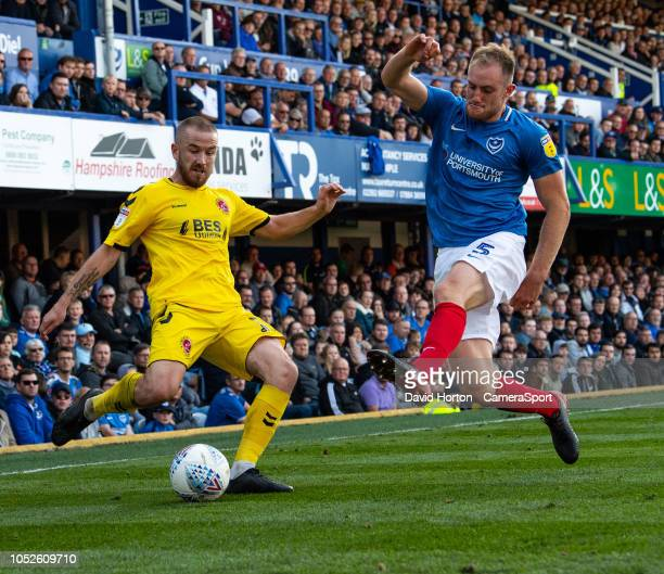 Portsmouth's Matthew Clarke battles with Fleetwood Town's Paddy Madden during the Sky Bet League One match between Portsmouth and Fleetwood Town at...