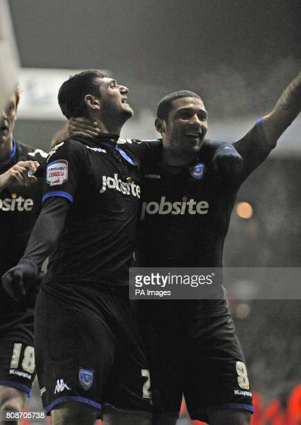 Portsmouth's Nadir Ciftci Hayden Mullins celebrate after their side equalize after Leeds United's Andrew O'Brien scored and own goal during the...