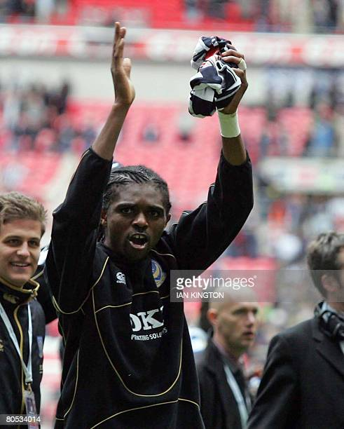 Portsmouth's Nigerian footballer Nwankwo Kano applauds the fans at the end during the FA Cup Semi Final football match at Wembley Stadium between...