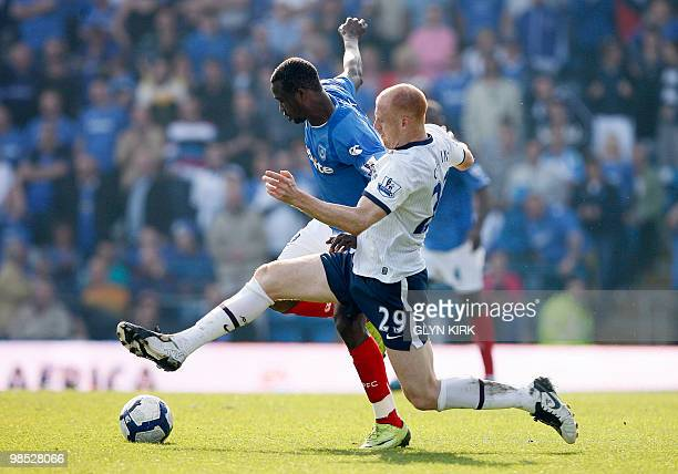Portsmouth's Nigerian striker John Utaka vies with Aston Villa's Welsh defender James Collins during their English Premier League football match...