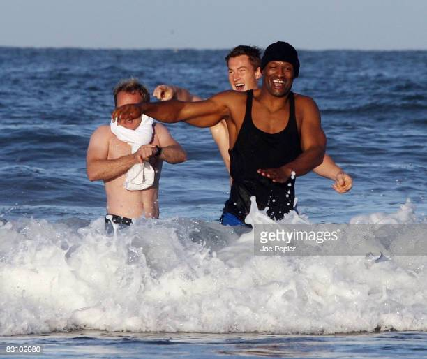 Portsmouth's Noe Pamarot and Jamie Ashdown laugh as the team celebrate in the Atlantic Ocean following their late night victory in the UEFA Cup Ist...