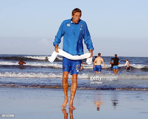 Portsmouth's Peter Crouch feels the chill as the team celebrate in the Atlantic Ocean following their late night victory in the UEFA Cup Ist round...