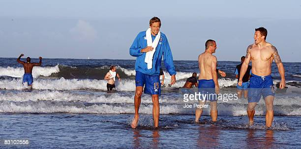 Portsmouth's Peter Crouch walks in the surf as the team celebrate in the Atlantic Ocean following their late night victory in the UEFA Cup Ist round...