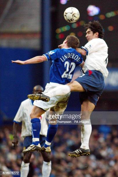 Portsmouth's Richard Hughes challenges Tobias Linderoth of Everton for the ball during their Barclaycard Premiership match at Everton's Goodison Park...