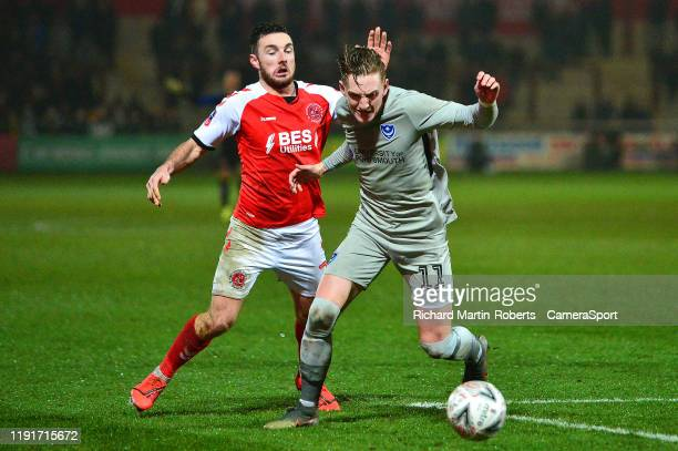 Portsmouth's Ronan Curtis vies for possession with Fleetwood Town's Lewis Coyle during the FA Cup Third Round match between Fleetwood Town and...