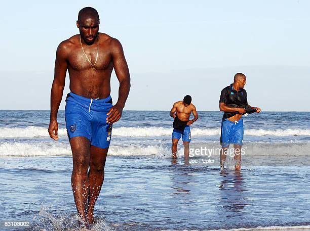 Portsmouth's Sol Campbell walks in the surf as the team celebrate in the Atlantic Ocean following their late night victory in the UEFA Cup Ist round...
