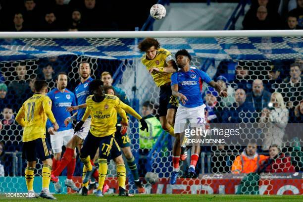 Portsmouth's Welsh forward Ellis Harrison jumps against Arsenal's Brazilian defender David Luiz during the English FA Cup fifth round football match...