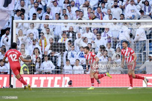 Portu of Girona celebrates after scoring his team's second goal during the La Liga match between Real Madrid CF and Girona FC at Estadio Santiago...