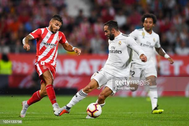 Portu of Girona FC competes for the ball with Daniel Carvajal of Real Madrid CF during the La Liga match between Girona FC and Real Madrid CF at...