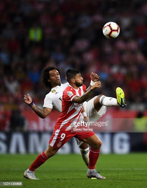 Portu of Girona FC competes for the ball with Marcelo Vieira of Real Madrid CF during the La Liga match between Girona FC and Real Madrid CF at...