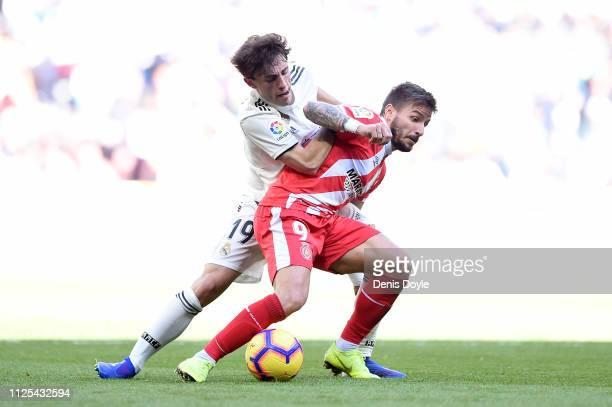 Portu of Girona is challenged by Alvaro Odriozola of Real Madrid during the La Liga match between Real Madrid CF and Girona FC at Estadio Santiago...