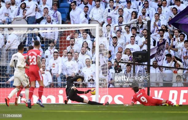 Portu of Girona scores his team's second goal during the La Liga match between Real Madrid CF and Girona FC at Estadio Santiago Bernabeu on February...
