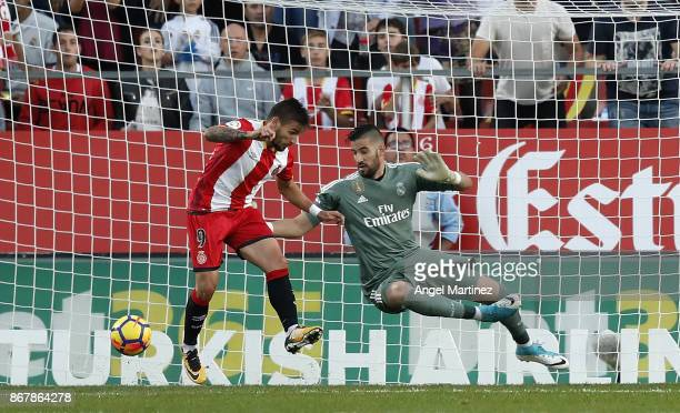 Portu of Girona scores his team's second goal past Kiko Casilla of Real Madrid during the La Liga match between Girona and Real Madrid at Estadi de...