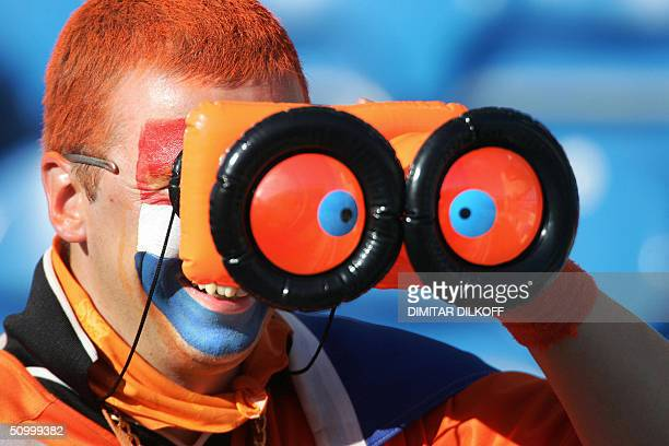 Dutch supporter waits for the beginning of the Euro 2004 quarter final match between Sweden and The Netherlands, 26 June 2004 at the Algarve stadium...