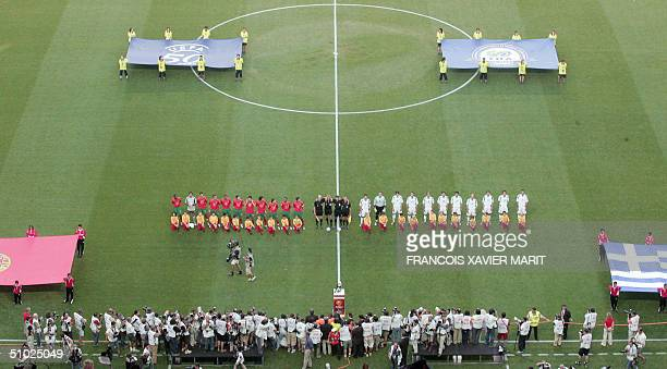 A general view of the teams as they stand for their respective national anthems 04 July 2004 at Stadio da Luz in Lisbon prior to the Euro 2004 final...