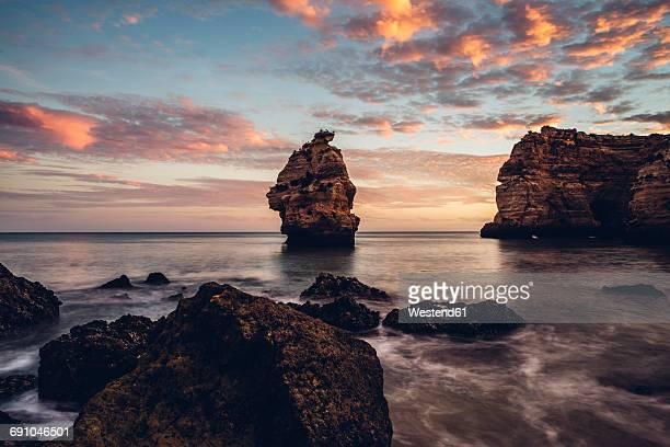 Portugal, Algarve, Albufeira, rock formation at sunset